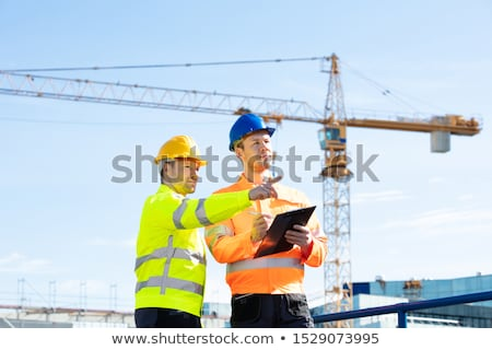Construction worker standing in front of a crane Stock photo © photography33