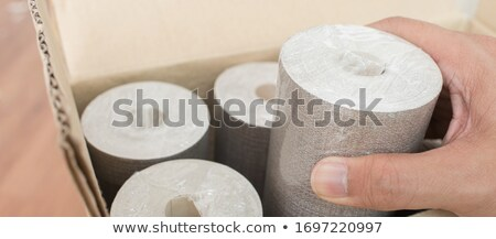 Man holding rolls of wallpaper Stock photo © photography33