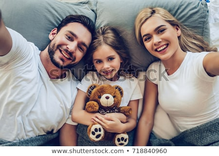 man with little girl playing with teddy bear stock photo © photography33