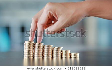 бизнесмен вверх Золотые монеты белый бизнеса фон Сток-фото © vlad_star