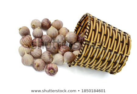 group of purple white garlic in basket macro Stock photo © juniart