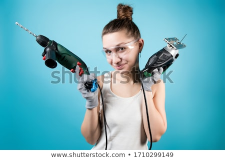 Woman with an electric jigsaw Stock photo © photography33