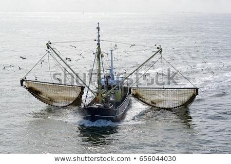 Vissersboot zee Blauw landschap Stockfoto © ivonnewierink