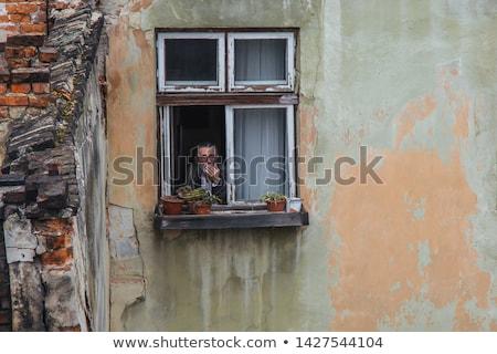 старший человека Постоянный окна глядя из Сток-фото © Kzenon