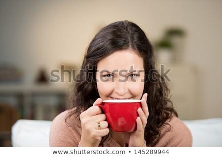 Woman enjoying a large cup of freshly brewed hot tea Stock photo © pxhidalgo
