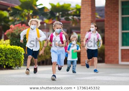 vissza · az · iskolába · nő · tanár · mosolyog · iskolatábla · női - stock fotó © stokkete