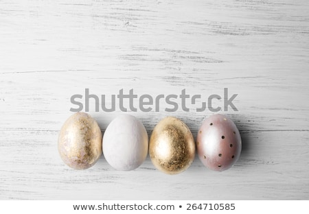 Decorative Easter eggs, on a rustic wooden table Stock photo © juniart
