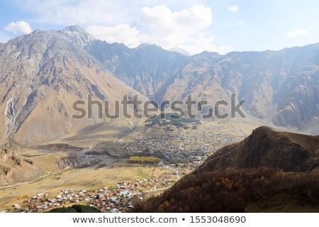 Kilátás szent hegy Kaukázus fa felhők Stock fotó © meinzahn