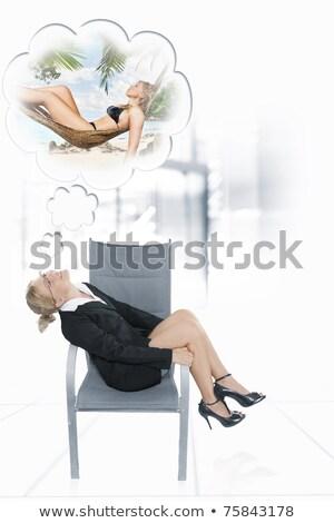 Secretary dreaming of a tropical vacation Stock photo © JackyBrown