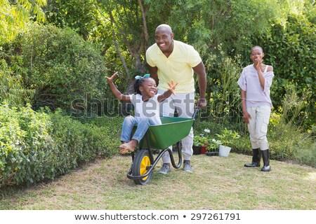 Twee jonge paren spelen kruiwagen vrouwen Stockfoto © monkey_business