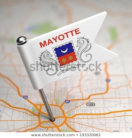 Mayotte Small Flag on a Map Background. Stock photo © tashatuvango