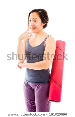 Young woman carrying exercise mat biting nail Stock photo © bmonteny