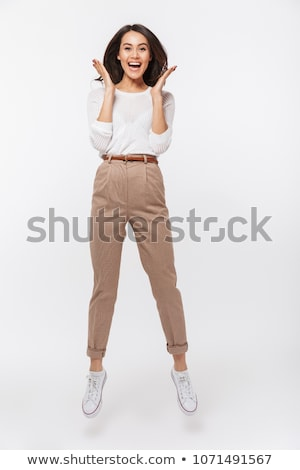 young asian woman jumping in excitement stock photo © bmonteny