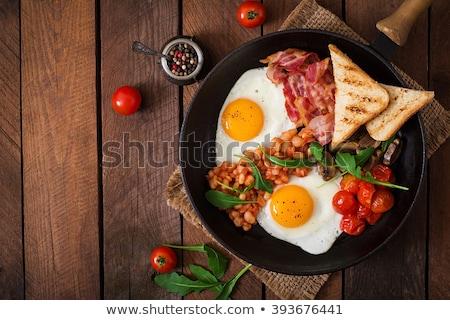 Pişmiş kahvaltı tok İngilizce sosis mantar Stok fotoğraf © neillangan