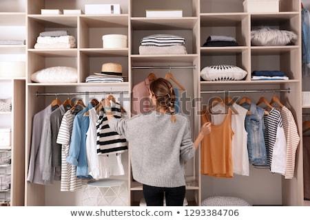 Nő ruhásszekrény fiatal nő alsónemű néz választ Stock fotó © RossHelen