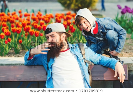 casual man enjoying a cigarette in the park stock photo © feedough