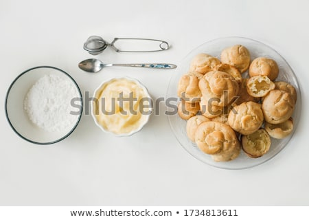 Fresh Baked Eclairs ready for Topping Stock photo © dariazu