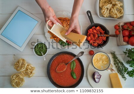 Young woman cutting vegetables in her modern kitchen  Stock photo © lightpoet