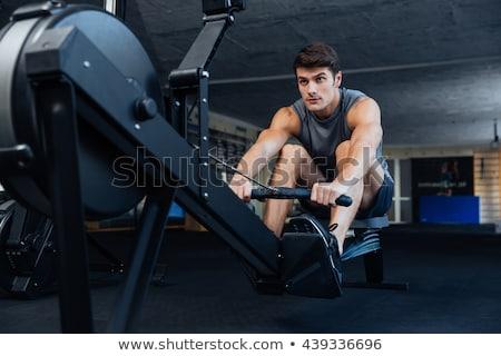 Caber homem remo máquina ginásio Foto stock © wavebreak_media