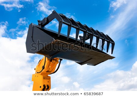 желтый гидравлический экскаватор черный ковша изолированный Сток-фото © rekemp