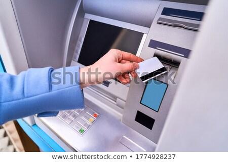 hand inserting card into cash dispense Stock photo © Mikko