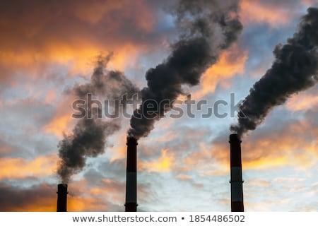 fumar · fábrica · dedicado · aço · céu · nuvens - foto stock © njnightsky