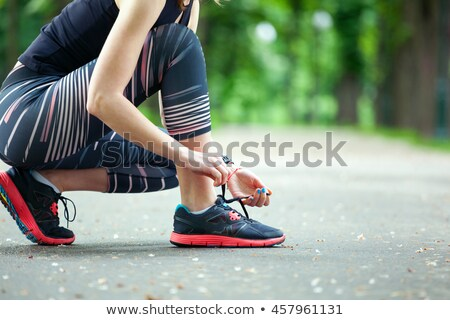 Woman trying her shoe lace Stock photo © wavebreak_media