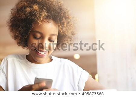 Charming tender smiling young woman sitting in cafe  Stock photo © deandrobot