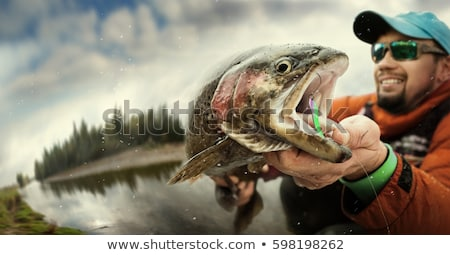 fisherman of lake in action when fishing stock photo © cozyta
