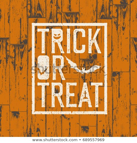 happy halloween logotype on orange colored wooden background g stock photo © pashabo