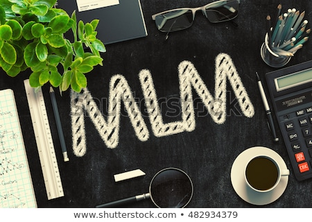 mlm handwritten on black chalkboard 3d rendering stock photo © tashatuvango