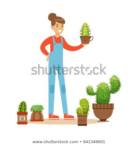 Stock photo: Woman holding flowerpots