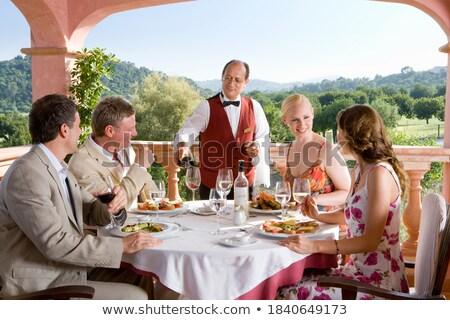 Waiter pouring wine in the glass Stock photo © wavebreak_media