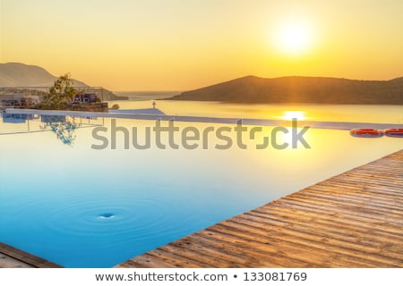 Sunrise over swimming pool Stock photo © simply