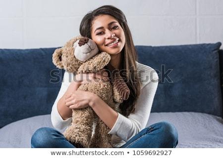 genç · kadın · oyuncak · ayı · gülen · portre · ayakta - stok fotoğraf © is2