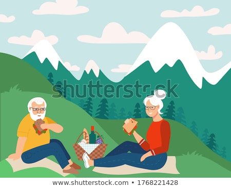 senior couple eating in mountains Stock photo © IS2