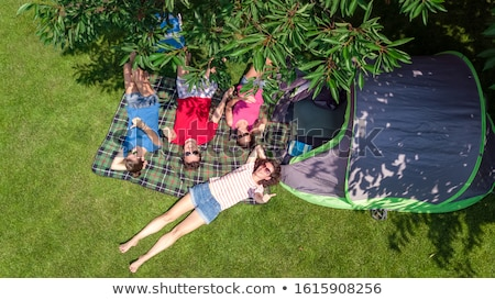 Girl relaxes under a tree Stock photo © IS2