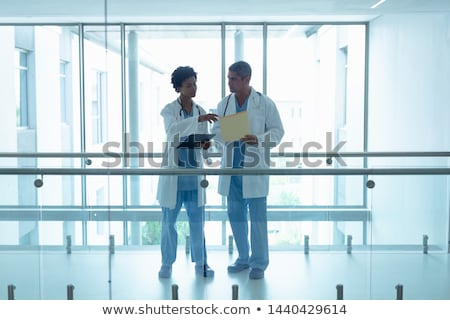 Surgeons interacting with each other Stock photo © wavebreak_media