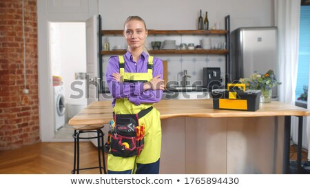 Plumber working on sink smiling Stock photo © monkey_business