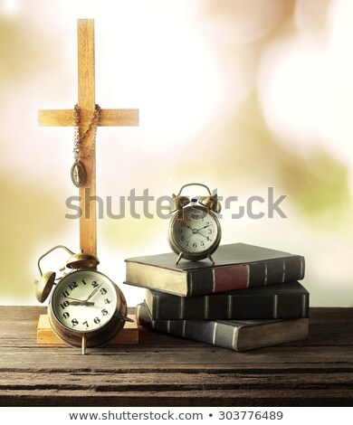 holy bible and old gold alarm clock on wood table stock photo © manaemedia