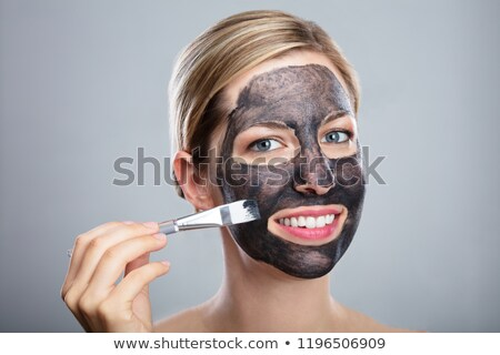 Nő jelentkezik faszén arc maszk ecset Stock fotó © AndreyPopov