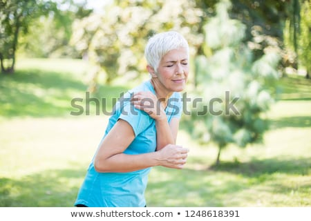 Kıdemli kadın omuz ağrısı park portre Stok fotoğraf © boggy