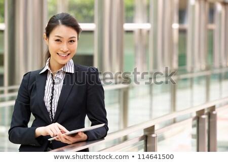 垂直 · 画像 · 笑みを浮かべて · ビジネス女性 · 座って · 屋外 - ストックフォト © deandrobot
