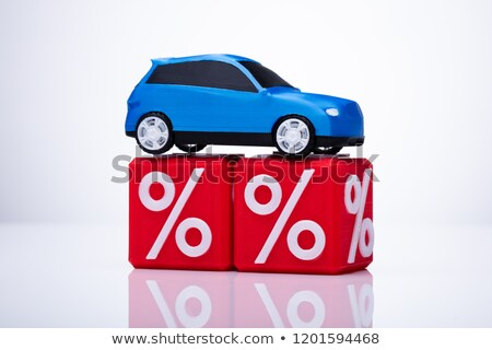 Blue Car Over Cubic Blocks With Percentage Sign Stock photo © AndreyPopov