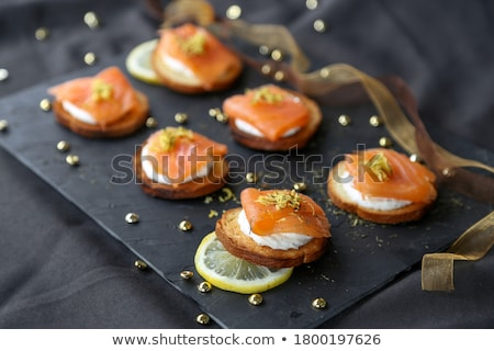Smoked salmon toasts Stock photo © YuliyaGontar