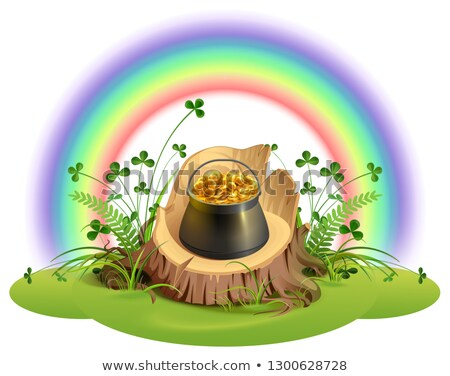 st patrick day pot of gold coins on stump under rainbow stock photo © orensila