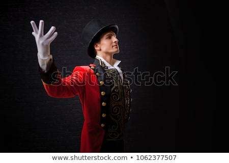 Portrait of young man in image of black magician with magic wand Stock photo © Stasia04