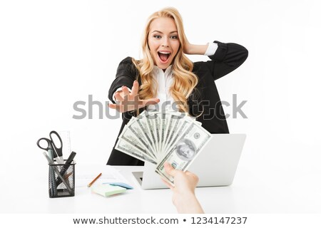 portrait of successful woman wearing office clothing grabbing do stock photo © deandrobot
