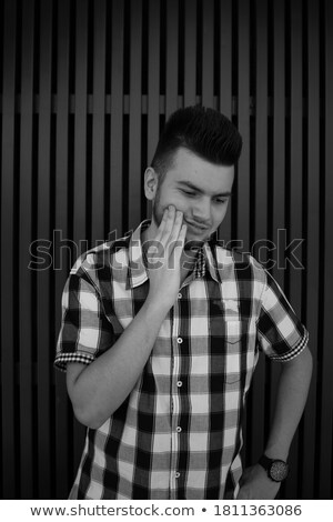 Zdjęcia stock: Unhappy Young Man Wearing Plaid Shirt Standing