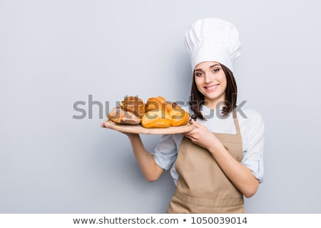 Young female baker isolated on white  Photo stock © Elnur